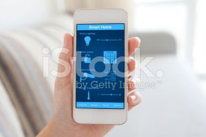 stock-photo-74632635-female-hand-holding-phone-with-smart-home-on-the-screen 3