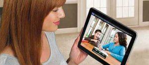 woman on iPad watching camera feed
